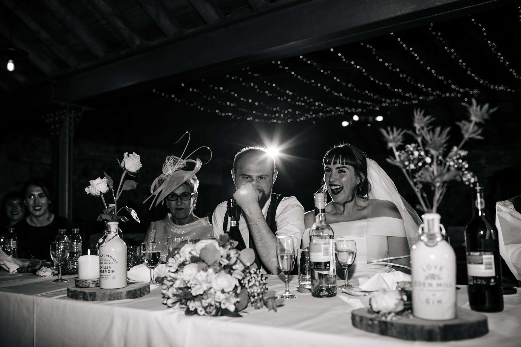 Bride and groom laughing during their wedding speeches at The Rhynd Leuchars