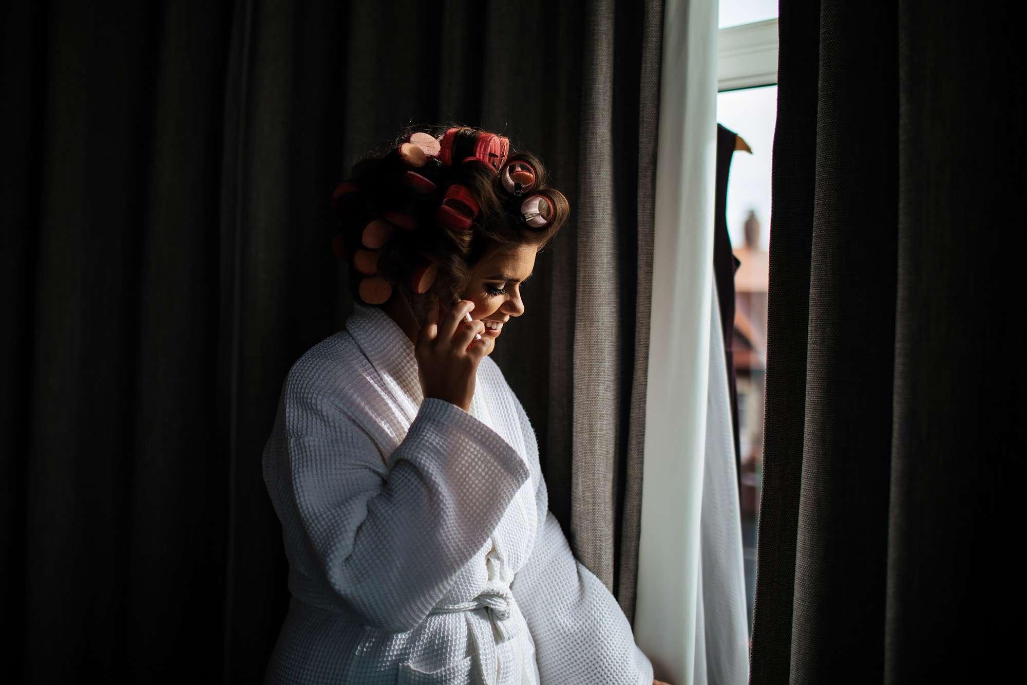 Bride on her wedding morning getting ready