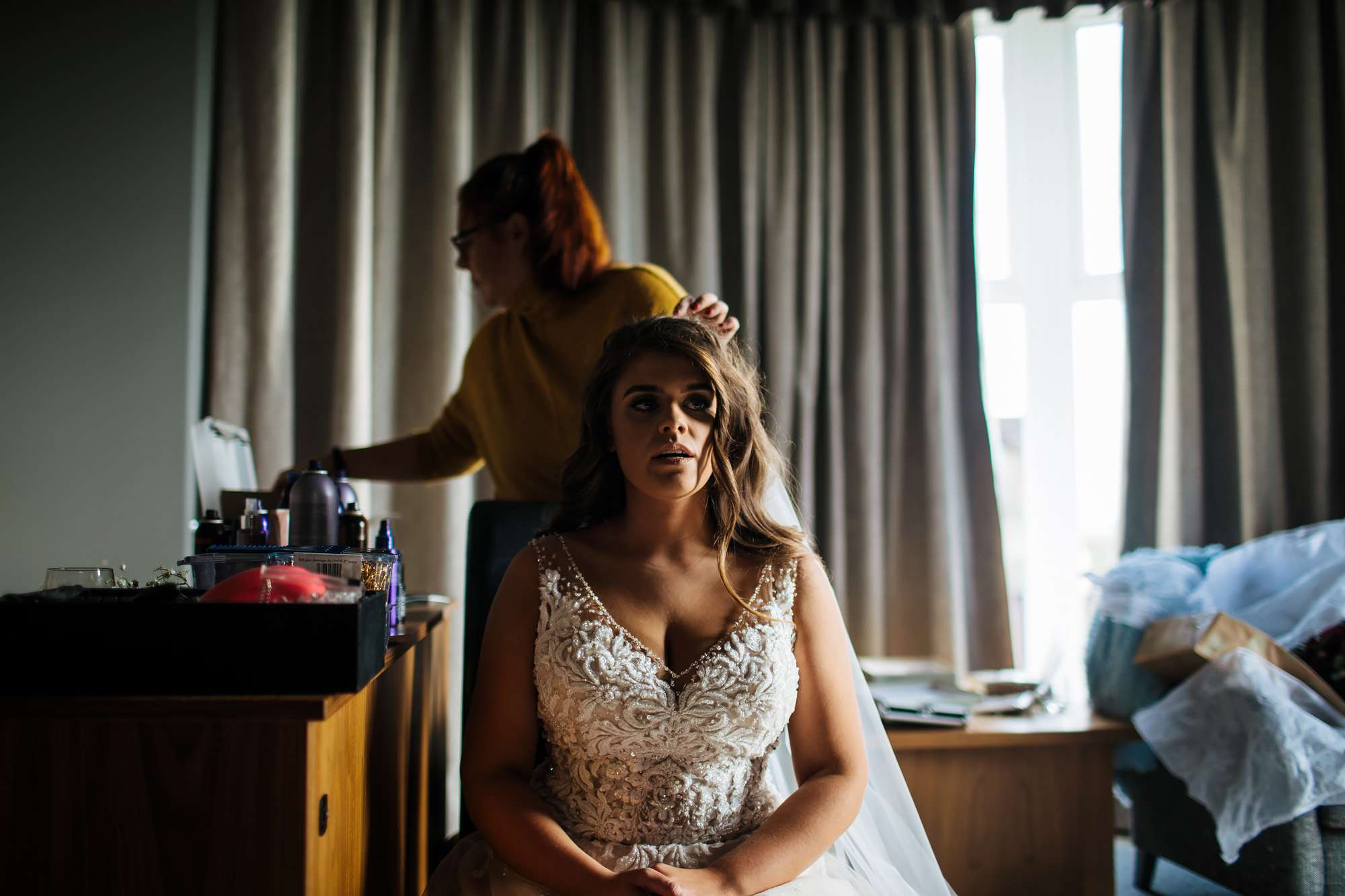 Bride has her hair finished on her wedding morning