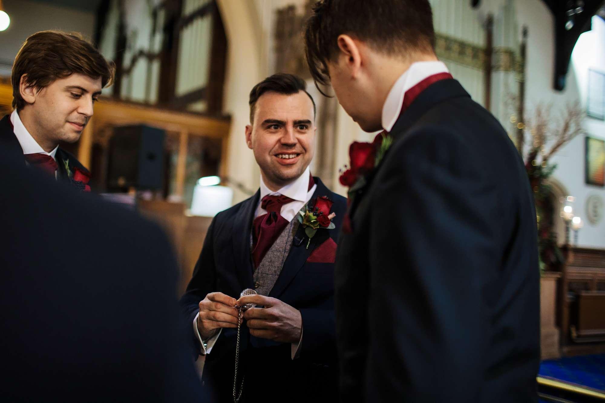 Groom joking with his groomsmen at a Blackpool wedding