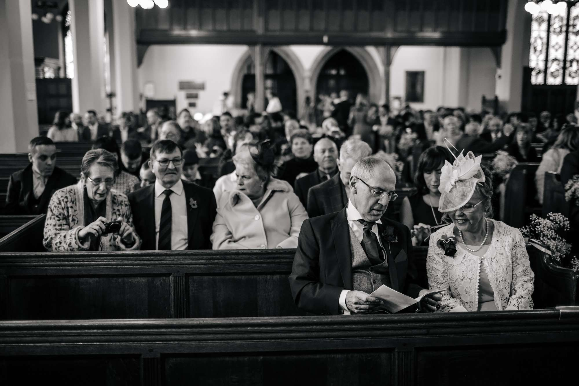 Grooms parent waiting in the church at a Blackpool wedding