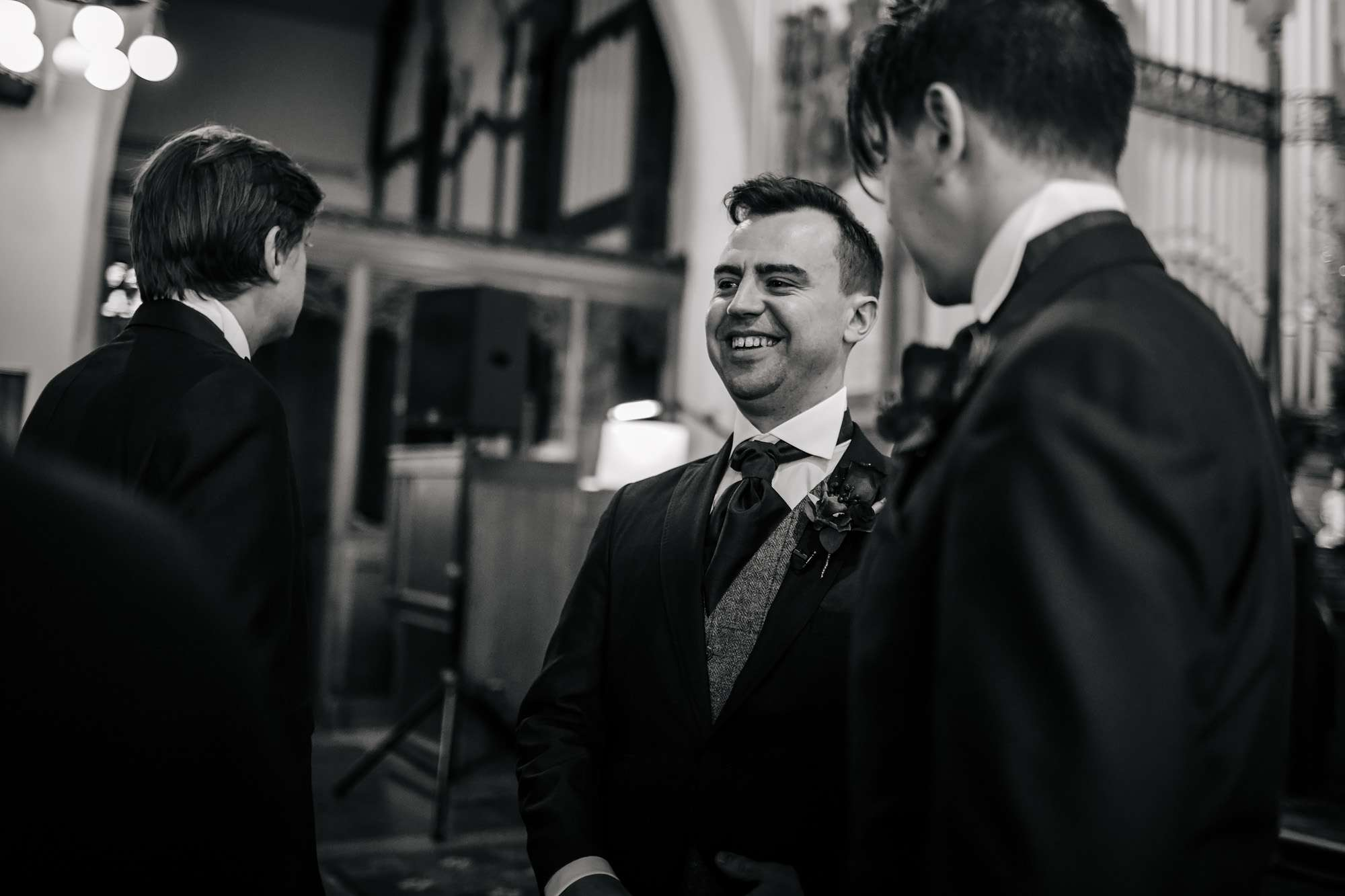 Groom waits in the church for his bride at a wedding