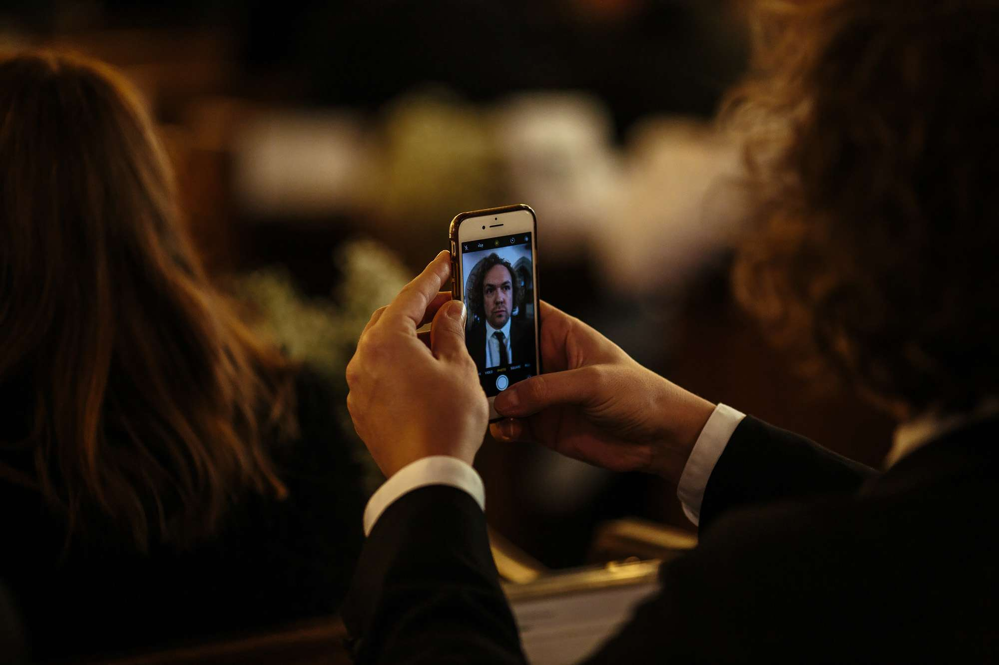 Wedding guest takes a selfie in the church