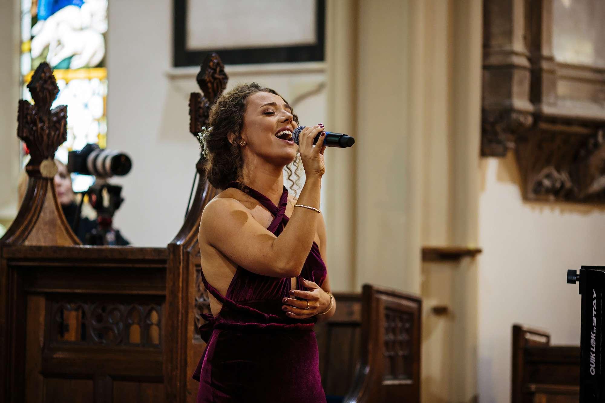 Bridesmaid singing at a Blackpool church wedding