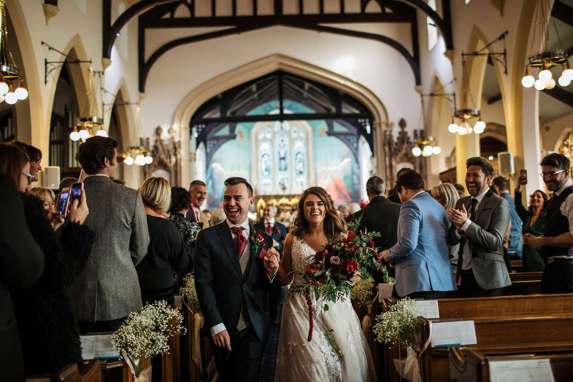 Bride and groom walk down the aisle at the church wedding