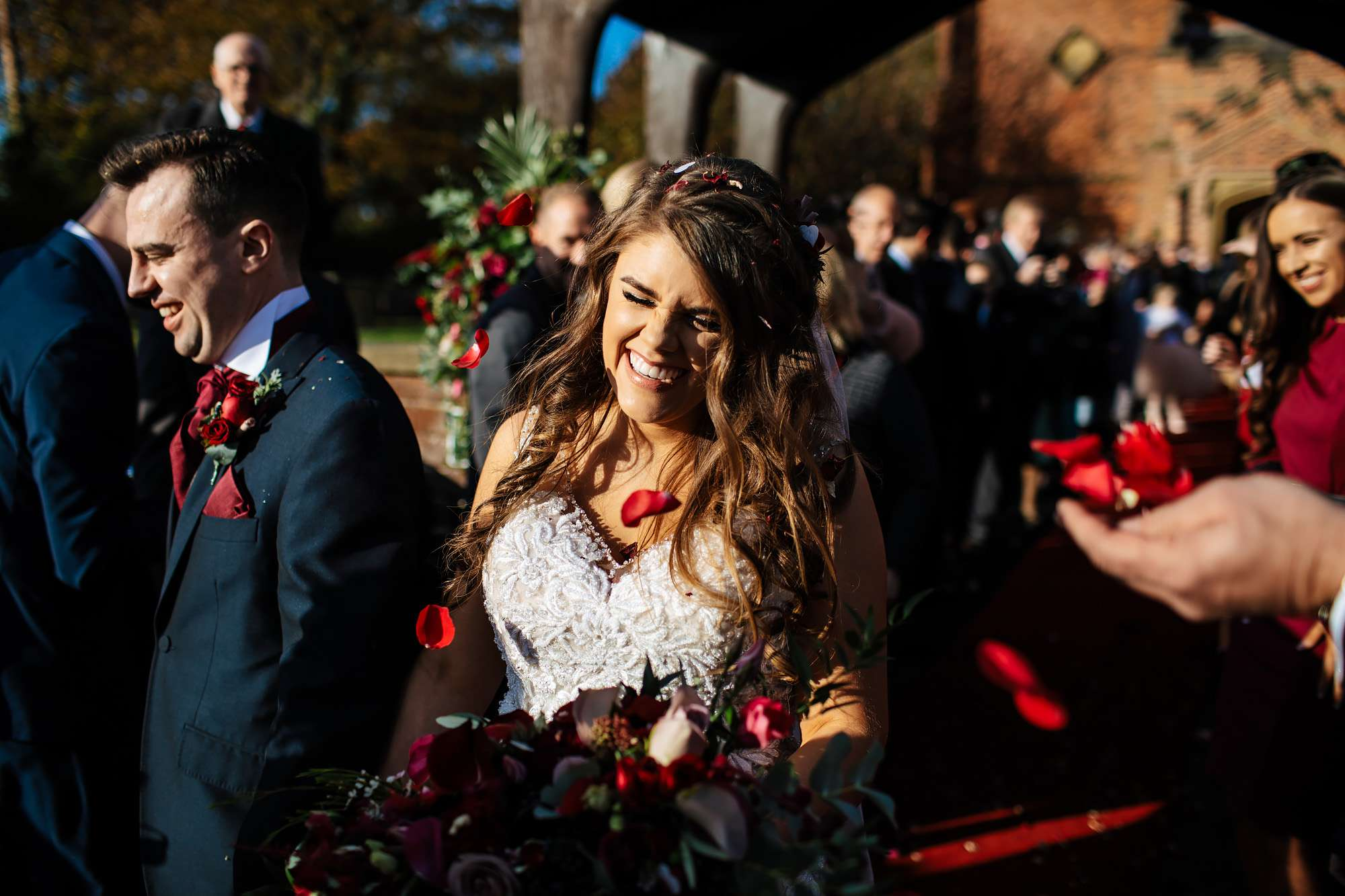 Bride and groom have confetti thrown over them