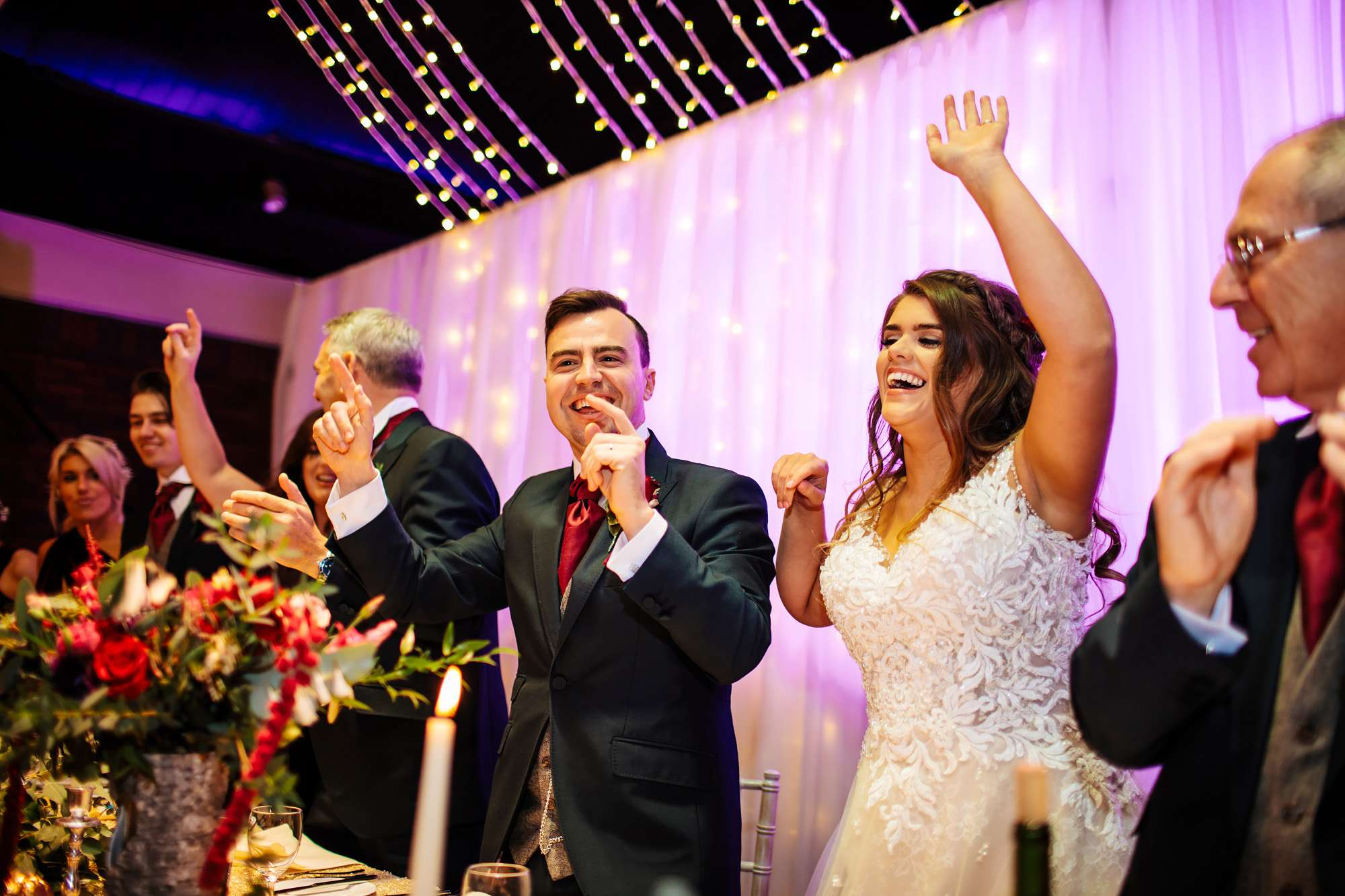 Bride and groom dancing at the top table wedding
