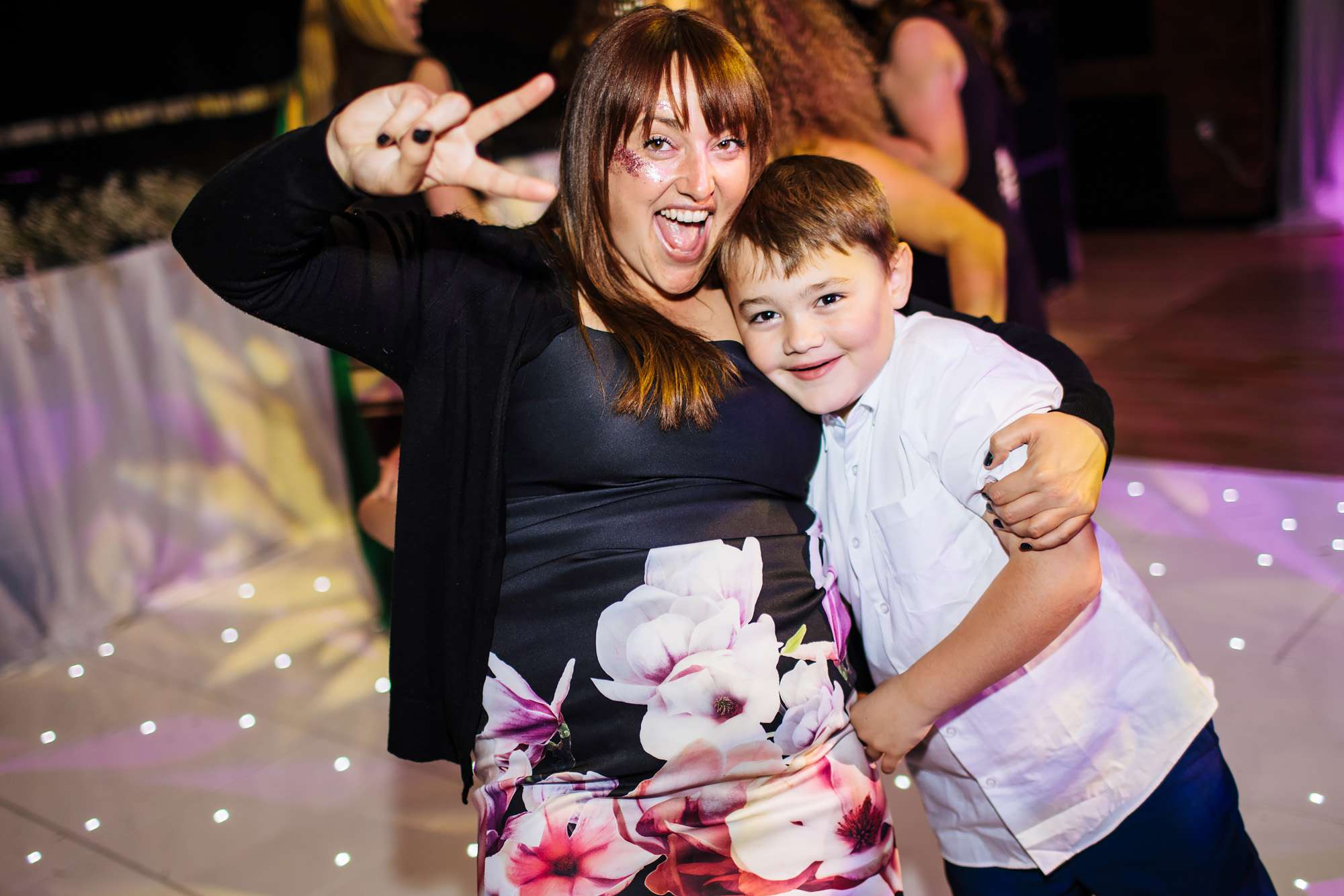Mum and boy at a wedding on the dance floor