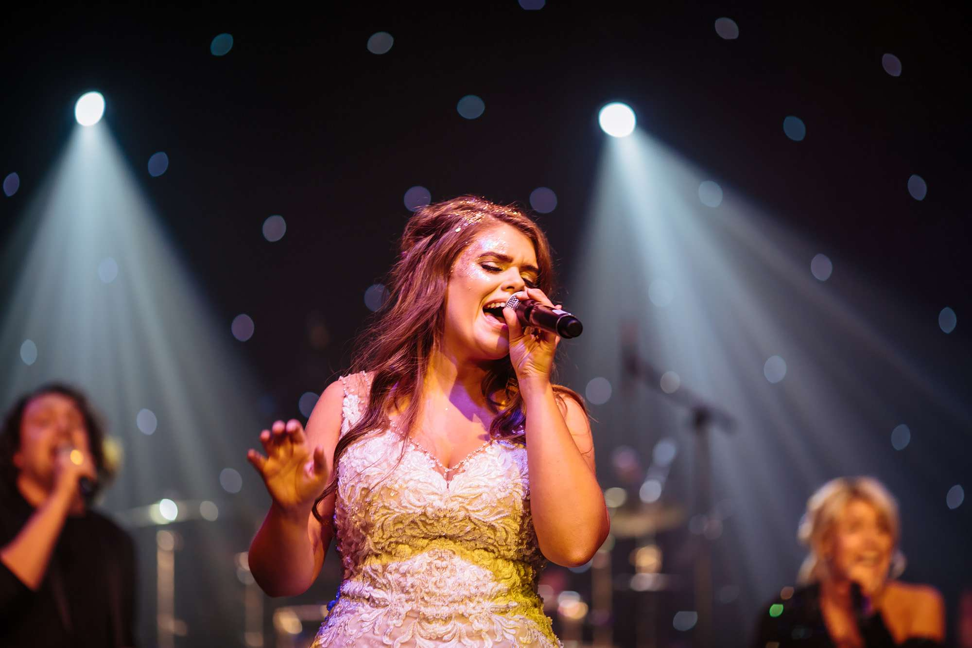 Bride performs with the band at her wedding in Blackpool