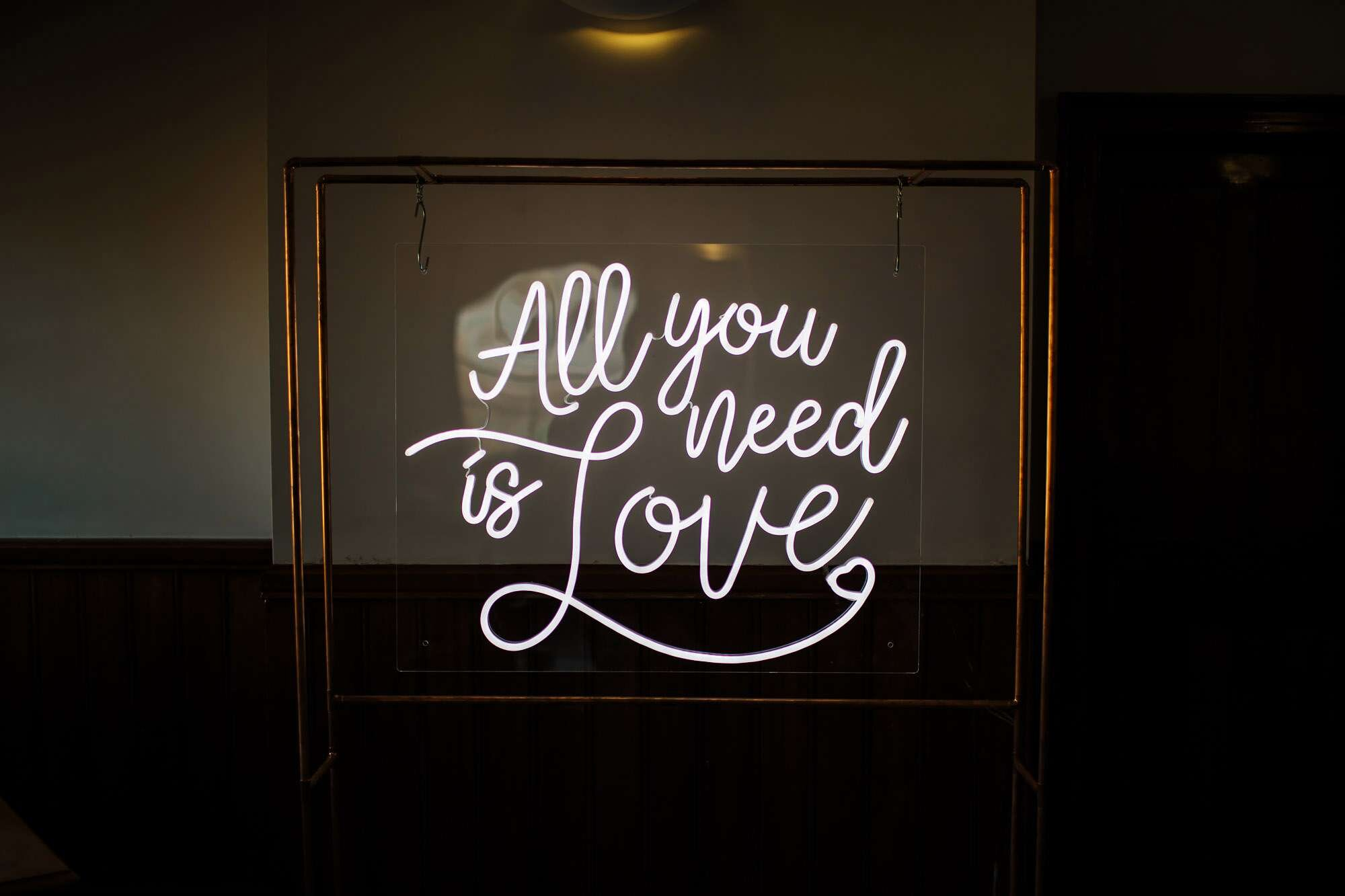 All you need is love neon sign at a wedding