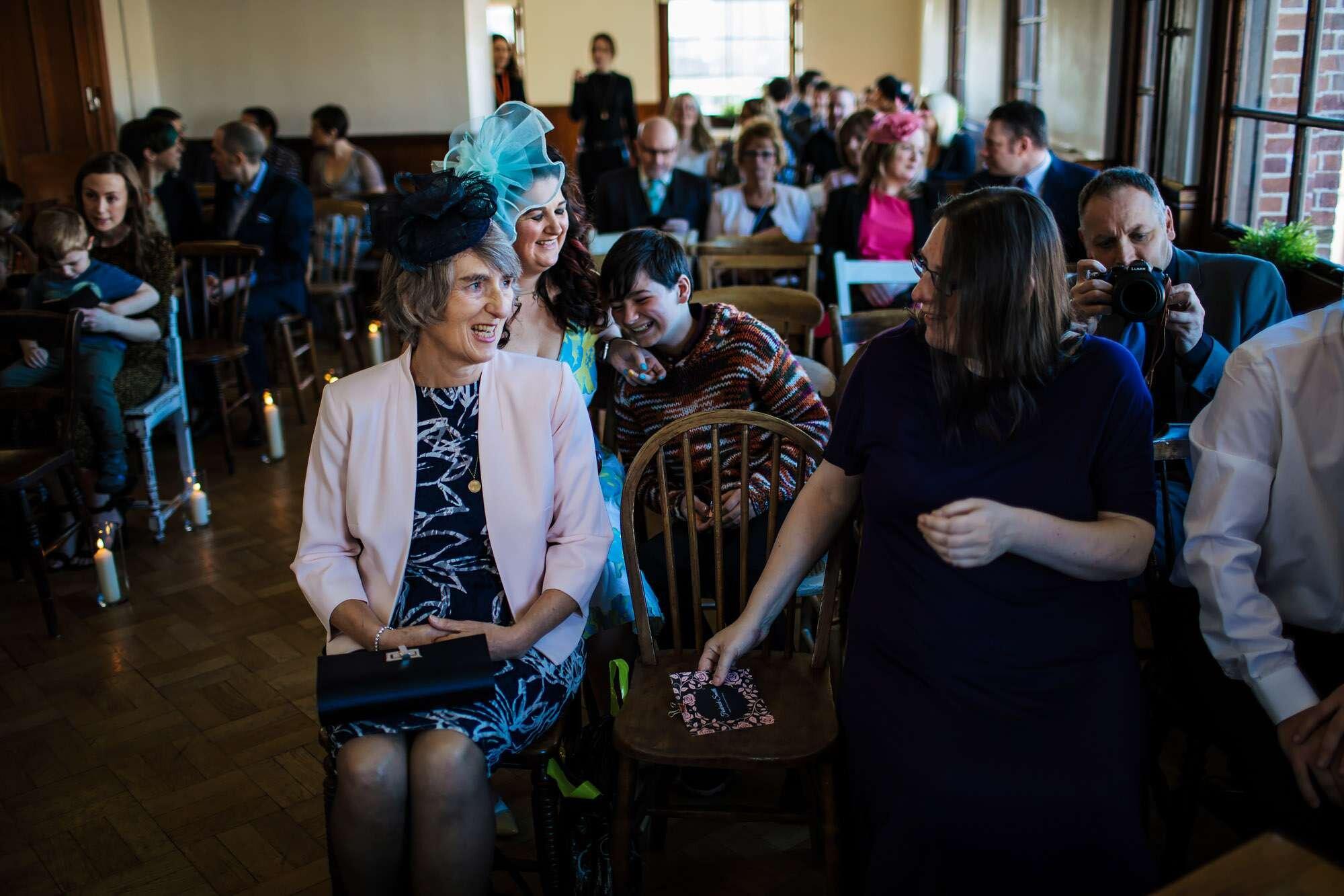 Brides mum smiles at the wedding ceremony