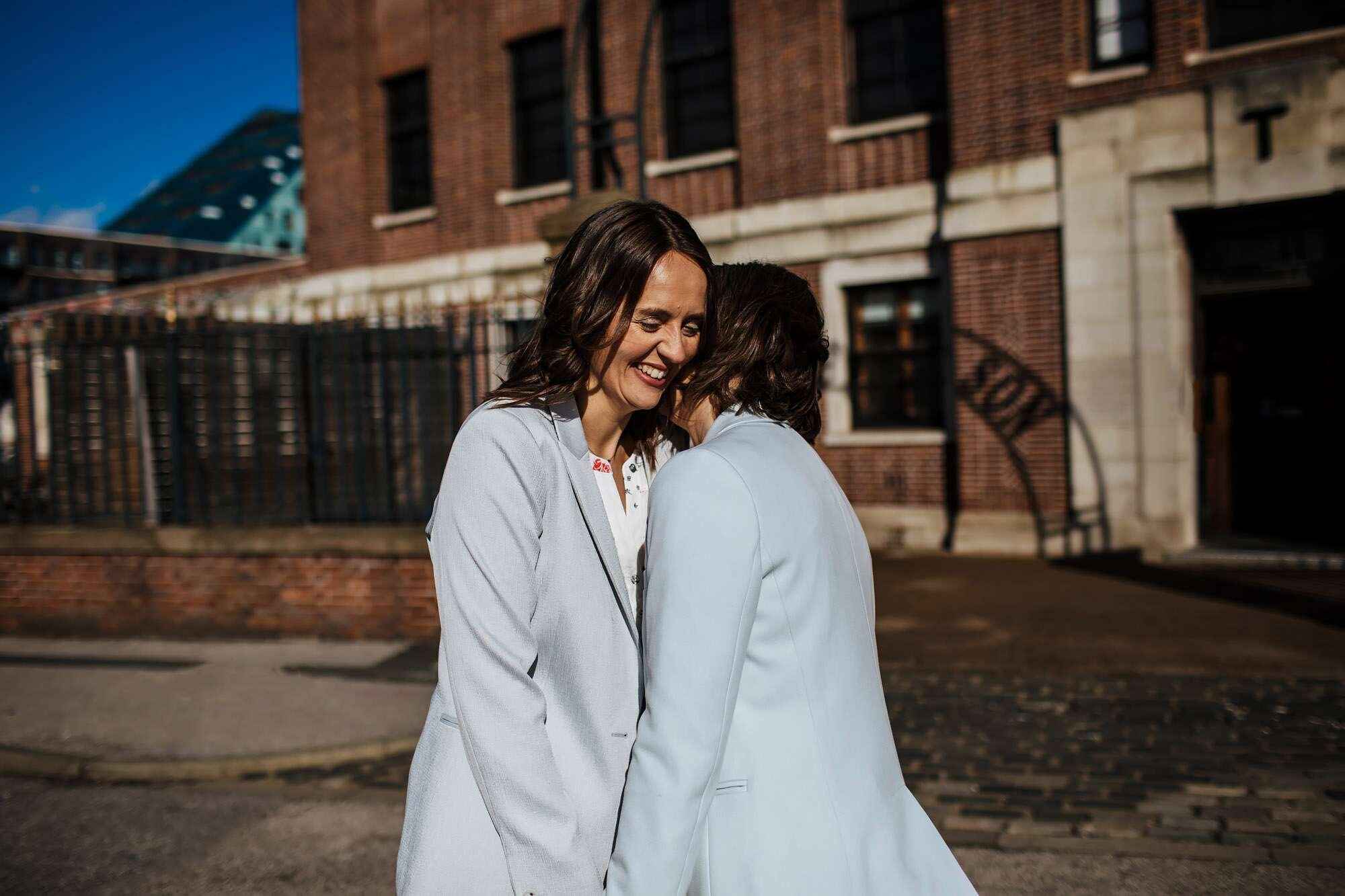 Two brides sharing a moment outside The Tetley Leeds