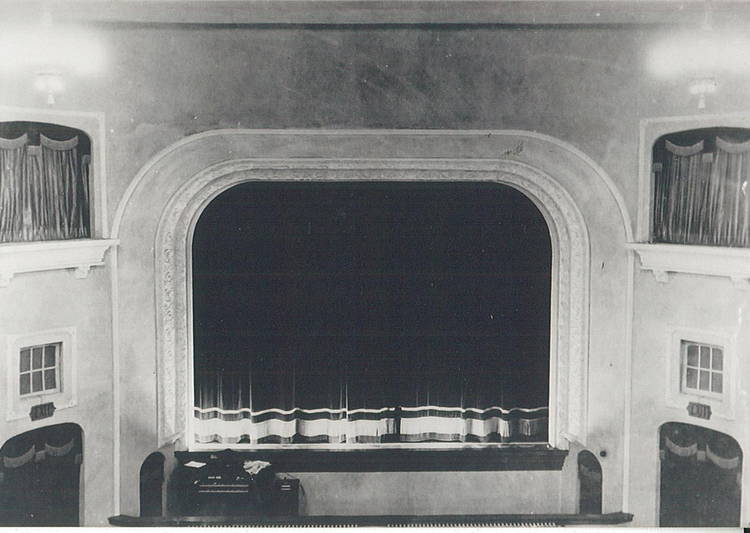 stage with curtain down 1920s.jpg