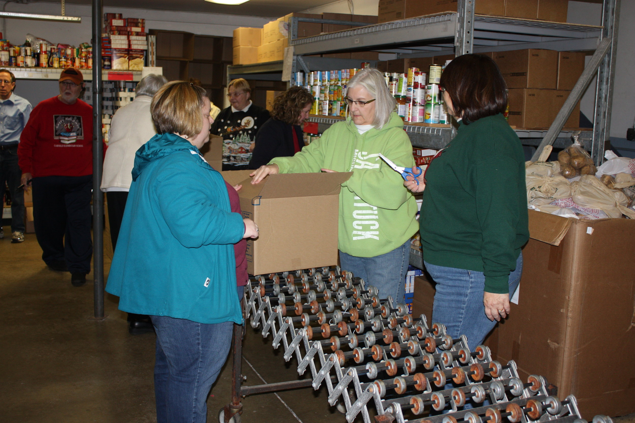 Local Civitans packing boxes of donated food at Associated Charities.