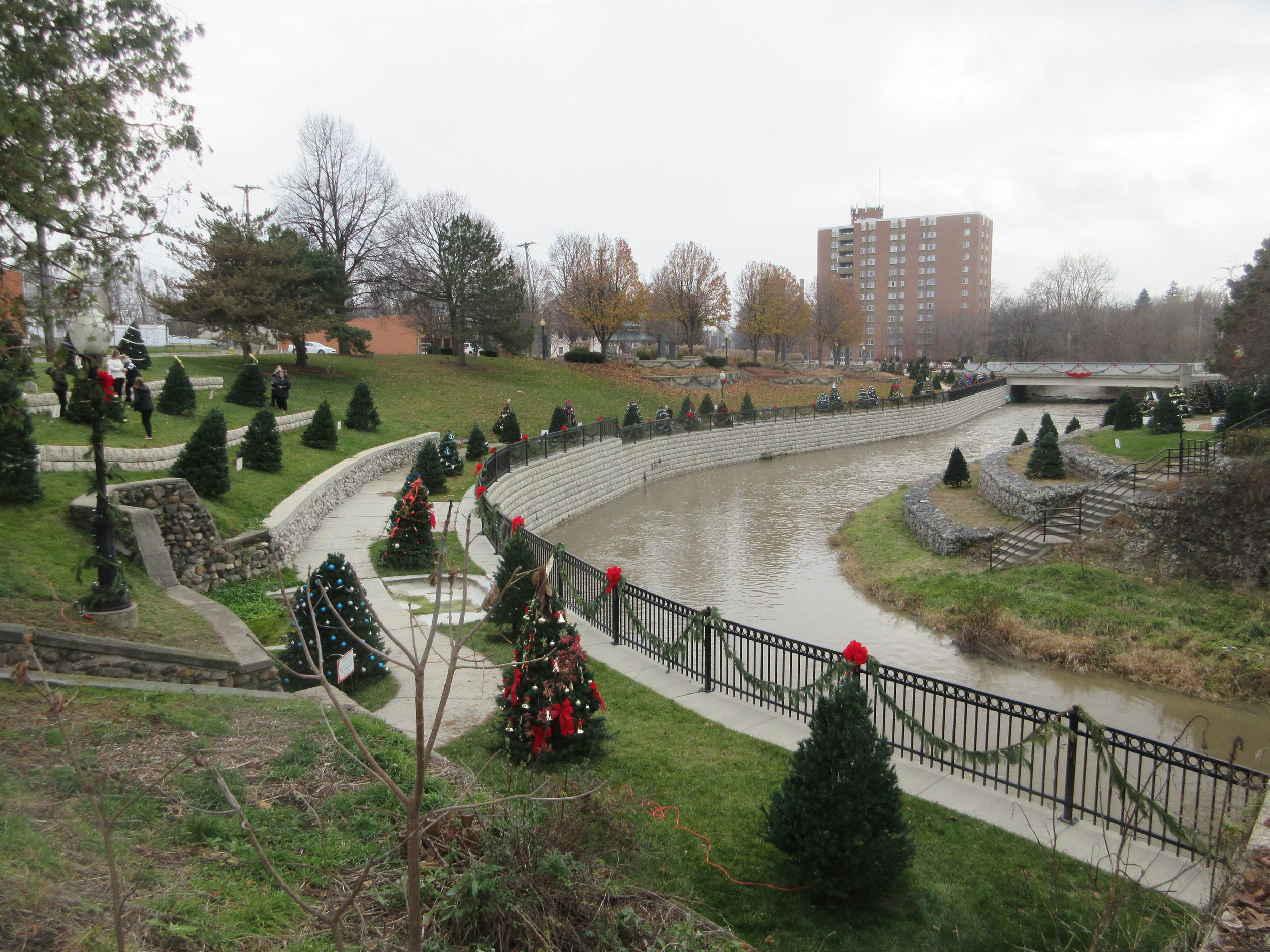 The local river walk in Adrian decorated with Christmas trees from the Civitan Tree Project.