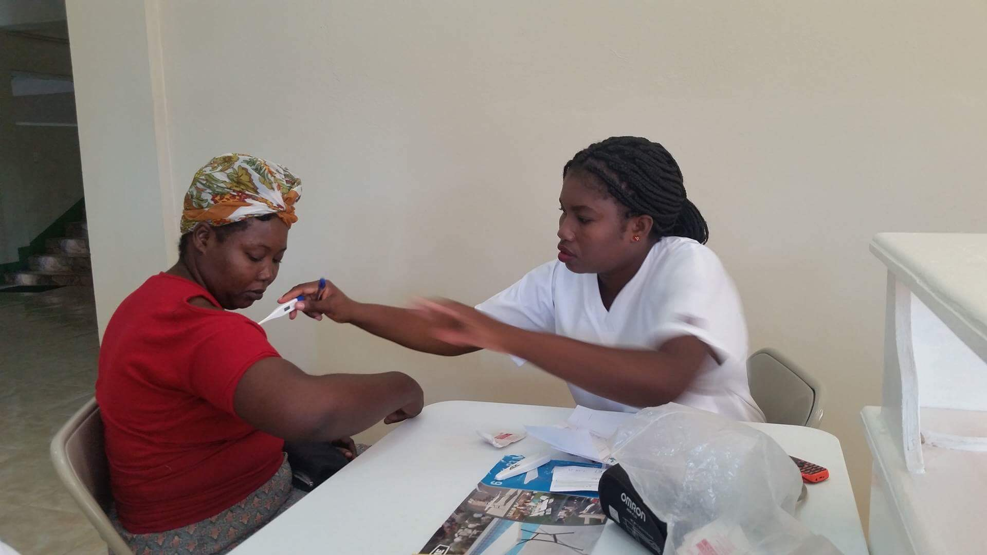 A nurse takes the temperature of a patient at the newly opened CHIDA Hospital in Cap Haitien, Haiti.