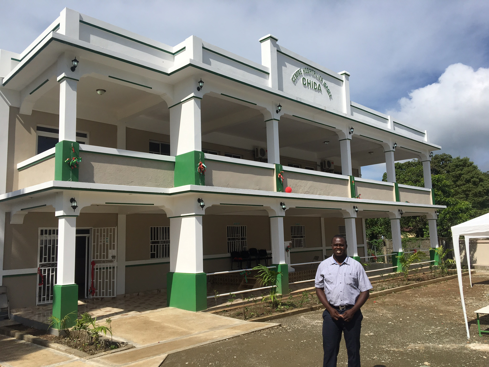 Dr. Wislyn Avenard (PKF Medical Director in Haiti) poses for a photo outside of the newly opened CHIDA Hospital in Cap Haitien, Haiti.