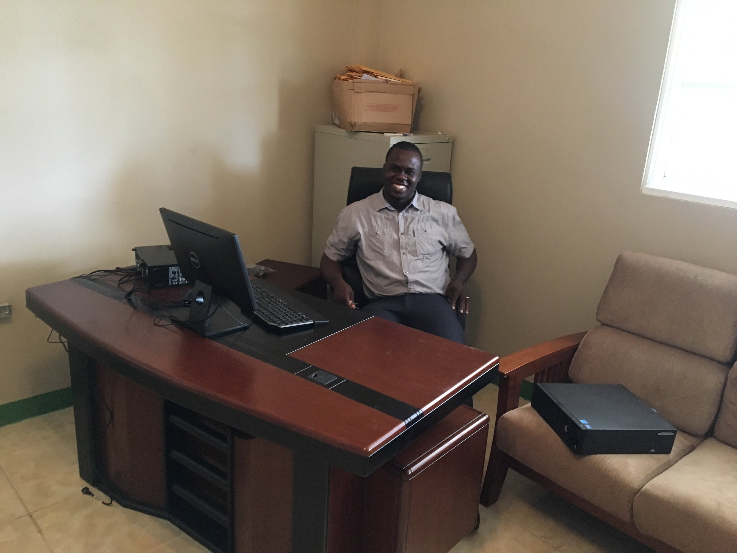 Dr. Wislyn Avenard in his office at the newly opened CHIDA Hospital in Cap Hatien, Haiti