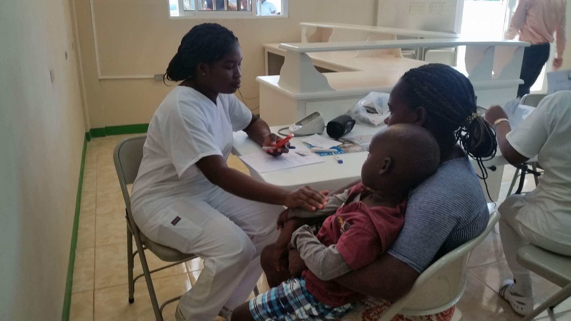 A young child receives medical care at the newly opened CHIDA Hospital in Cap Haitien, Haiti