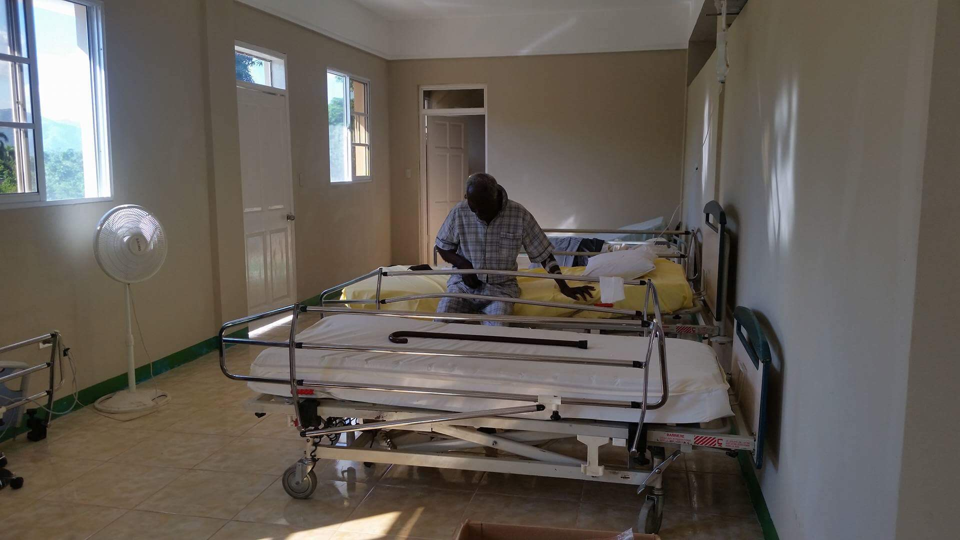 A patient sits on a hospital bed in the newly opened CHIDA Hospital in Cap Haitien, Haiti