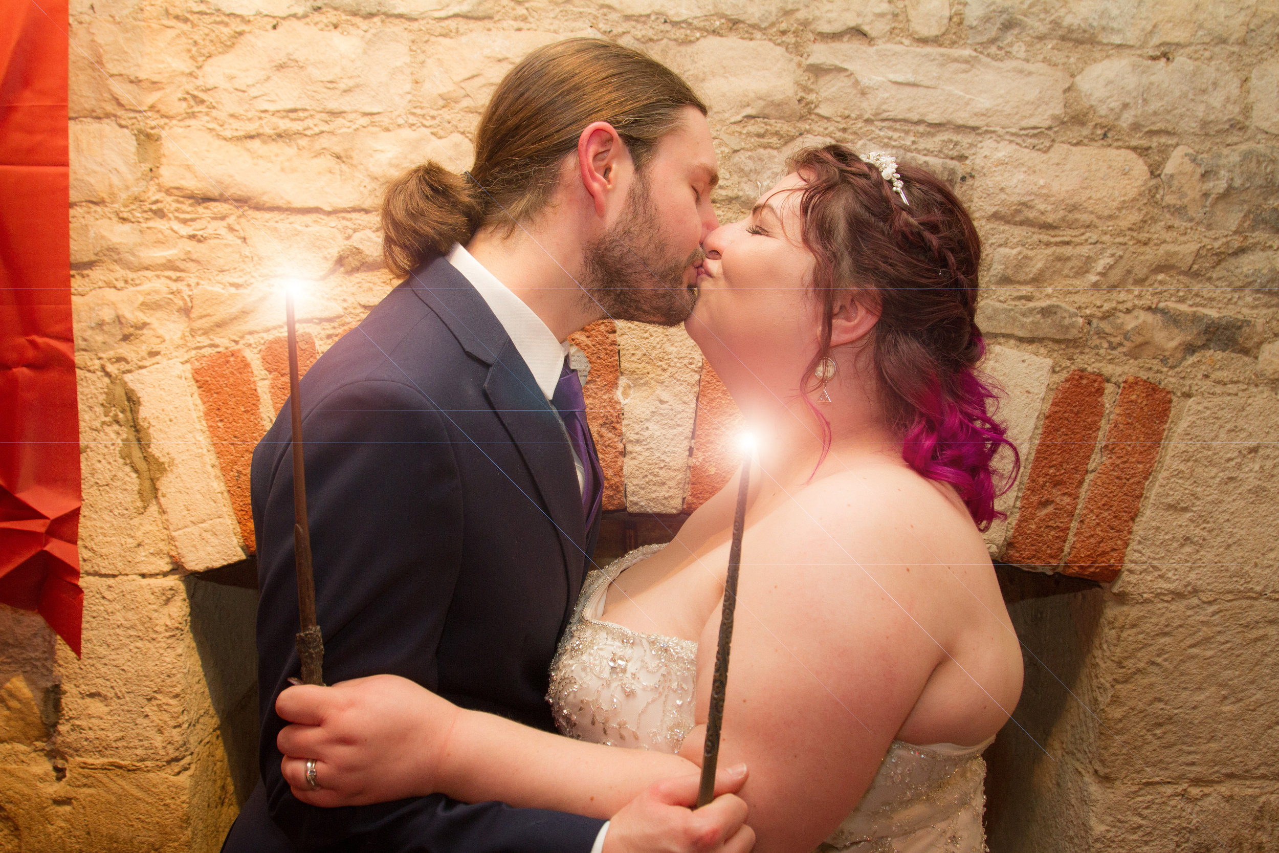 Zoe and Ollie Wedding-553 wands.jpg