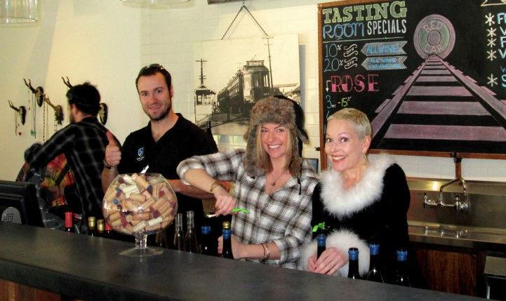 Author and Head of VineSpring Customer Success, Britney Yunker , far right, behind the bar enjoying barrel-tasting weekend at Red Car Wine.