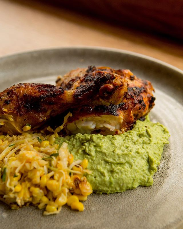 Just how we like our chicken - oven roasted to perfection over a pillow of Pea Hummus & Mexican Corn Off the Cob!