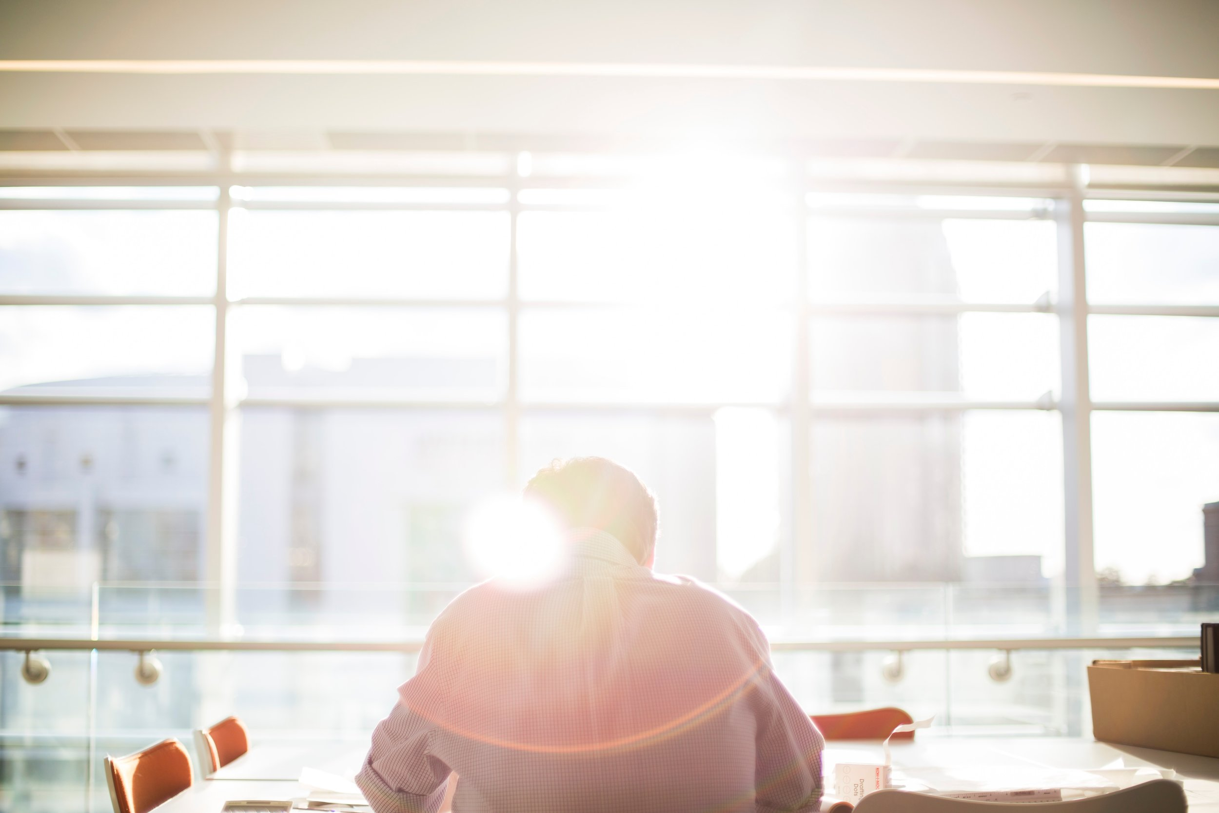 man working at a desk in the sunlight