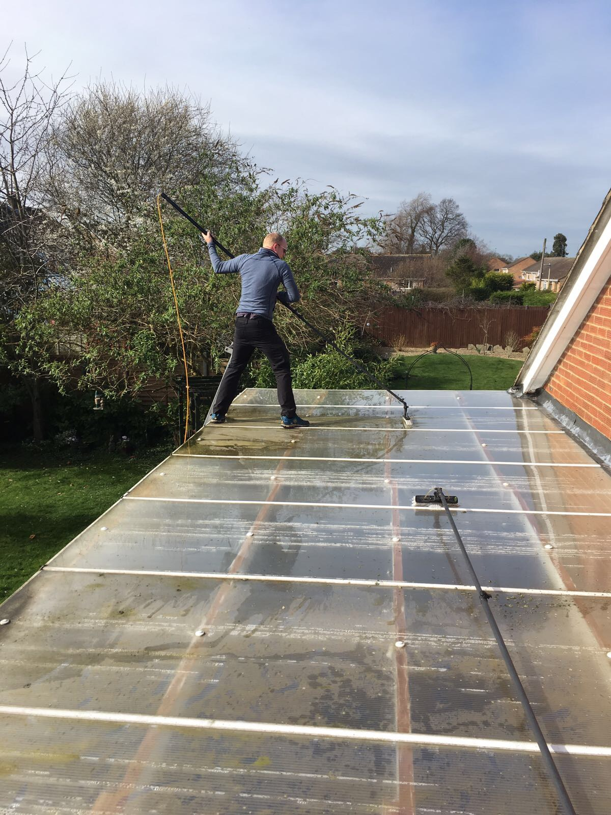 Carefully cleaning the canopy roof