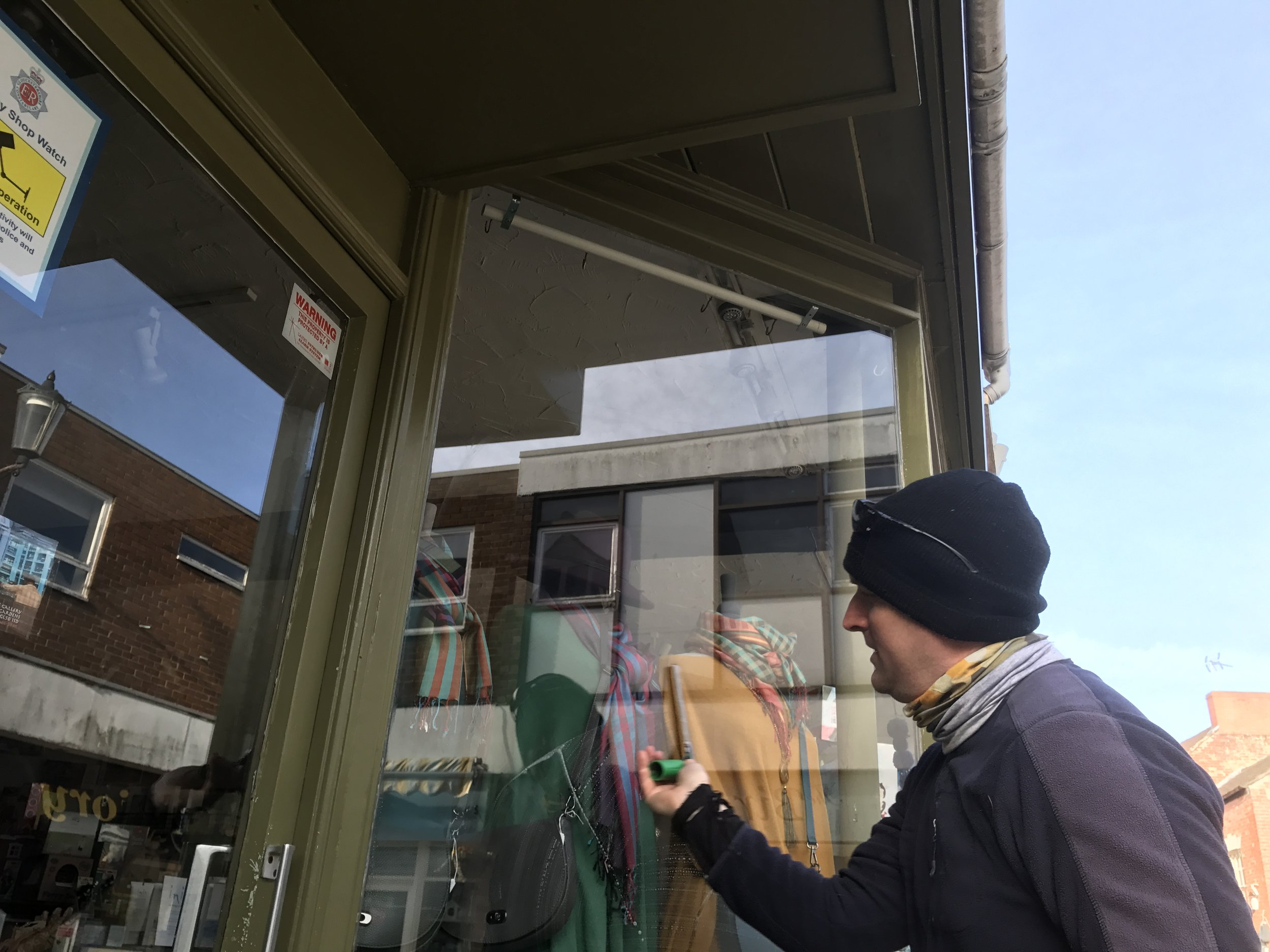 Cleaning 'That New Shop' windows in Dursley