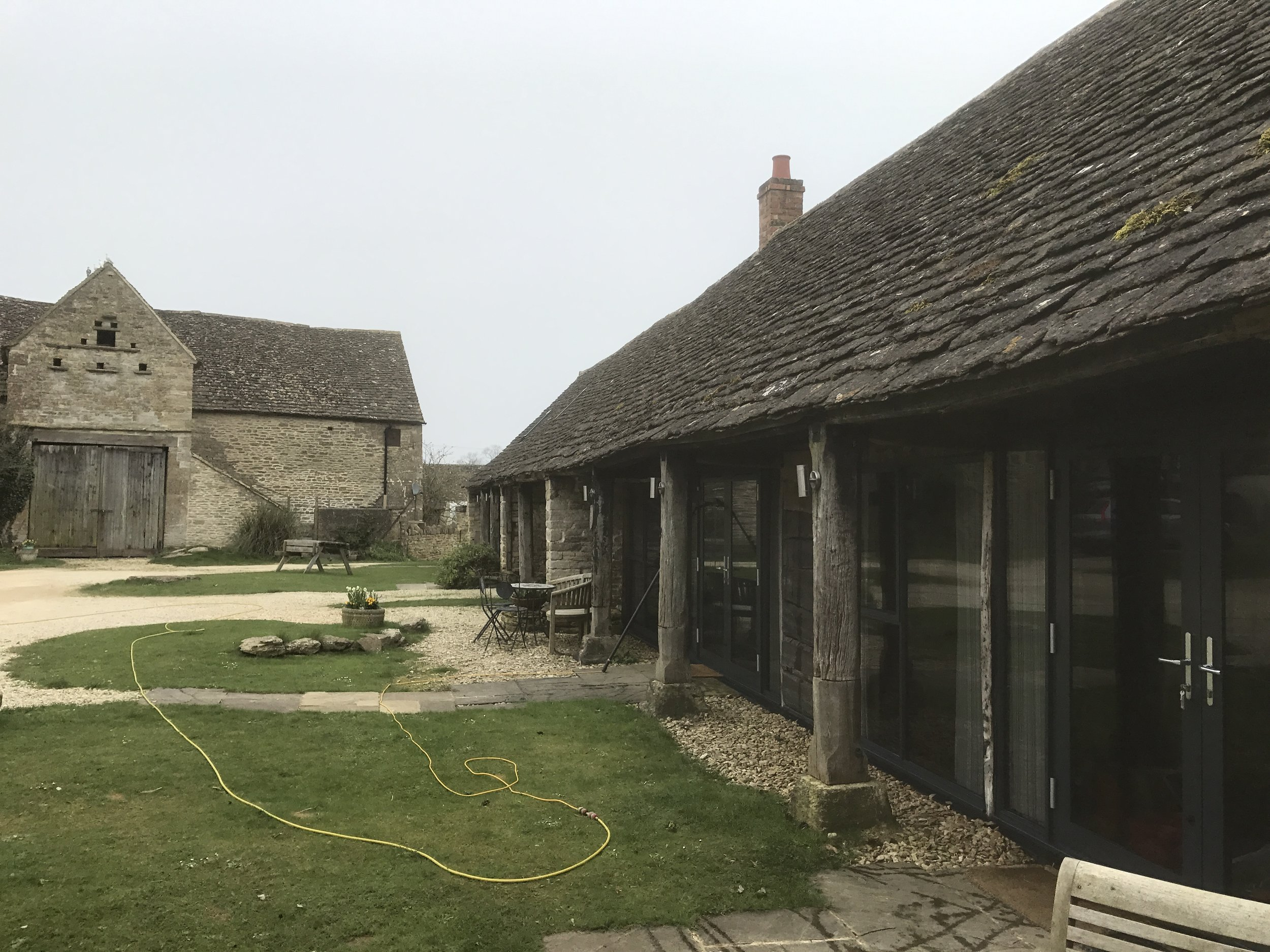 Cotswold stone barns converted into holiday accommodation