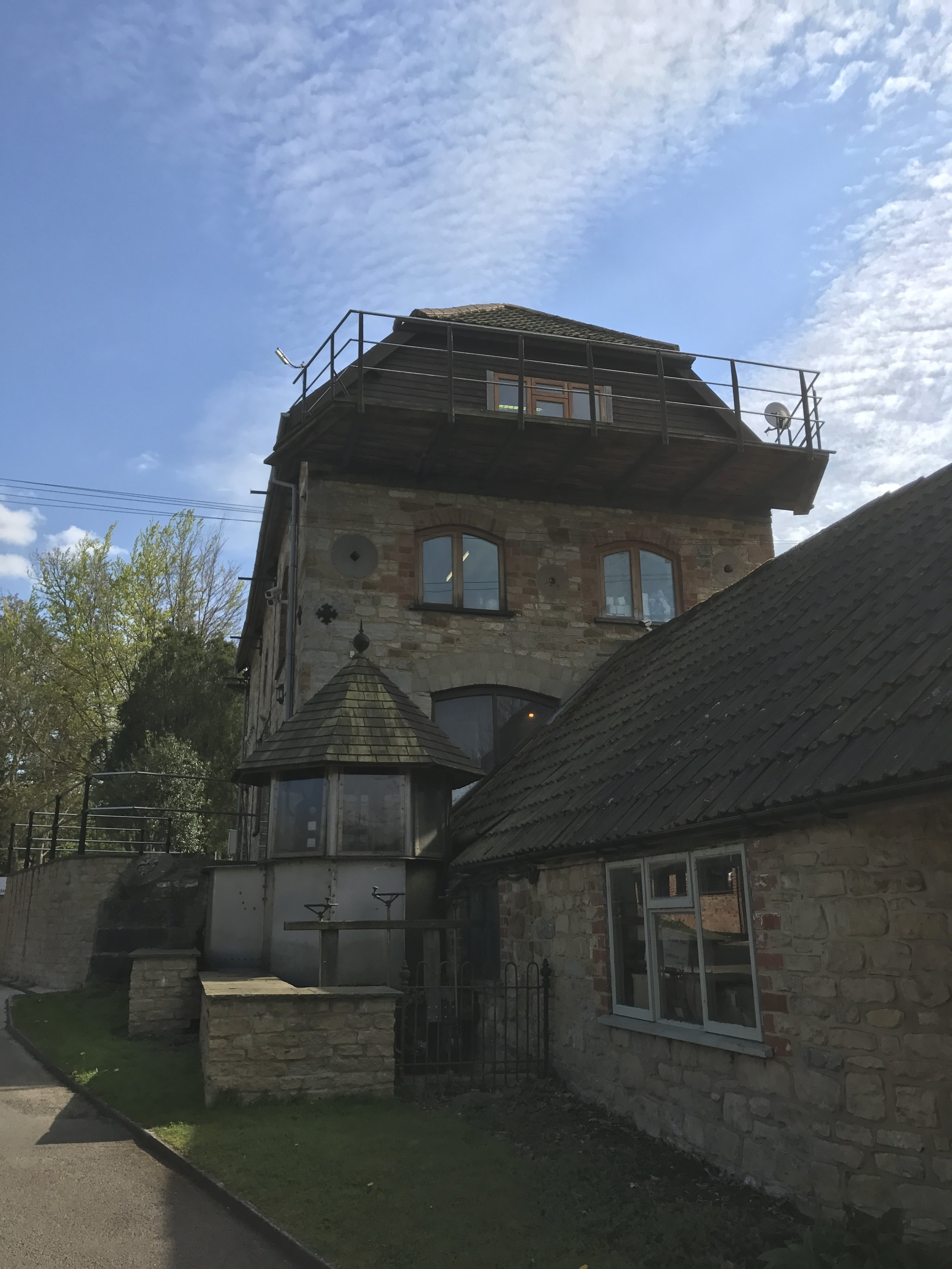 View of the end of house with balcony