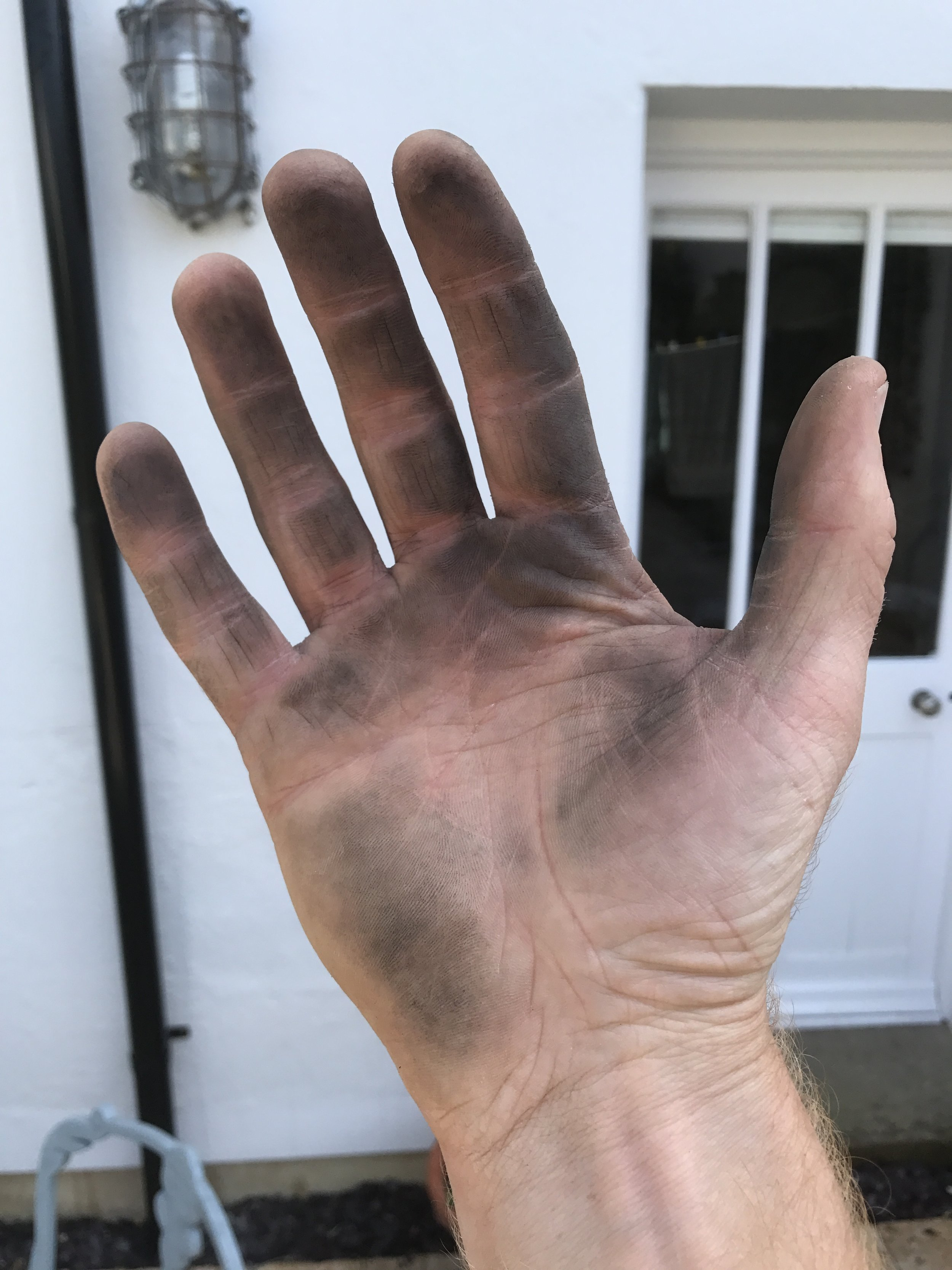 The pole is starting to wear out so the carbon deposits can transfer to your hand!