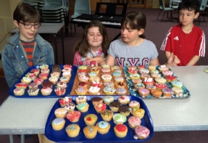 Selling cakes for Christian Aid