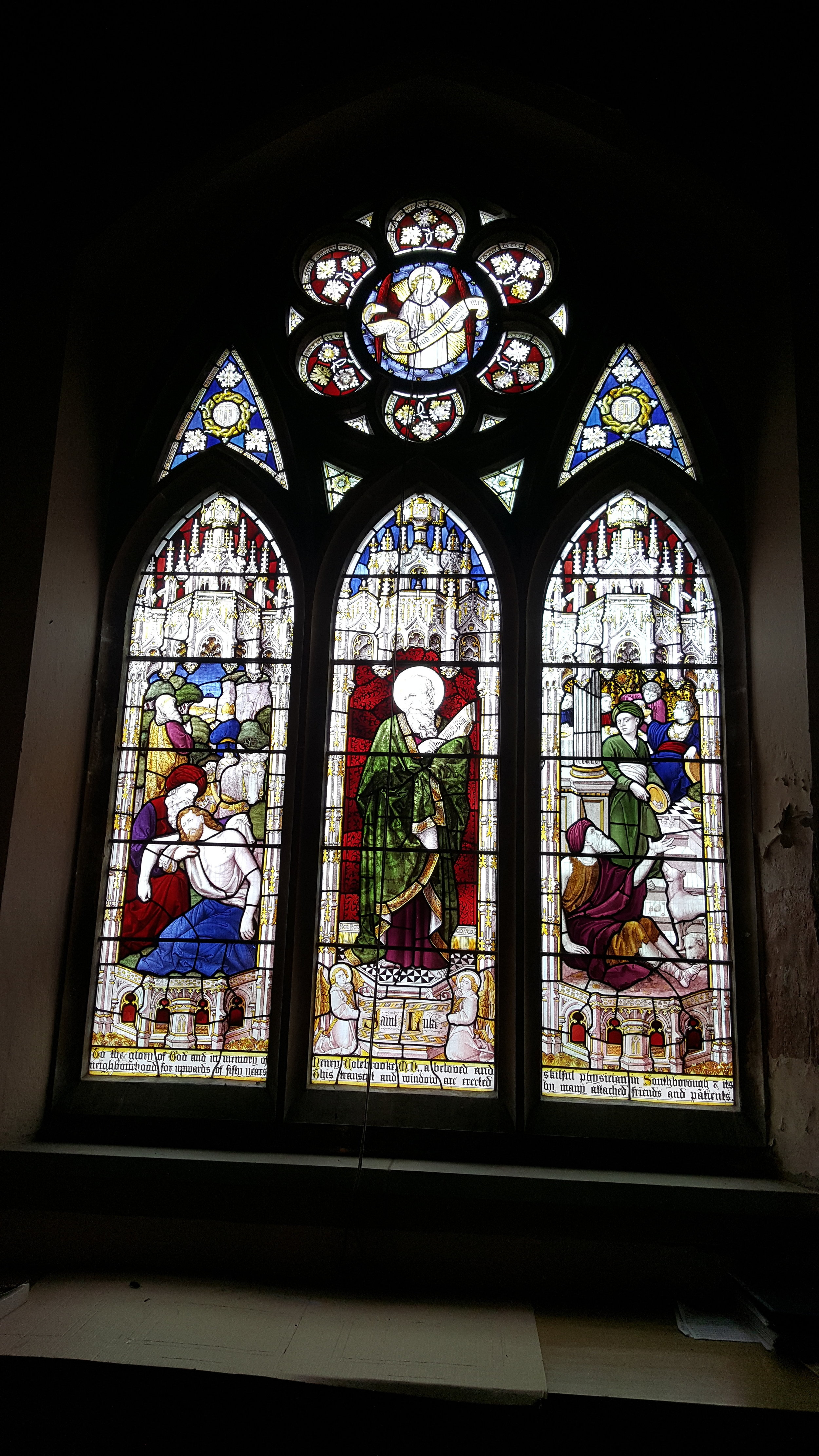 The window in the Colebrooke chapel, with the walls around in need of repair and redecoration