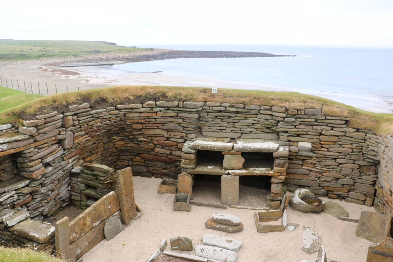 A neolithic home at Skara Brae beside the Bay of Skaill.