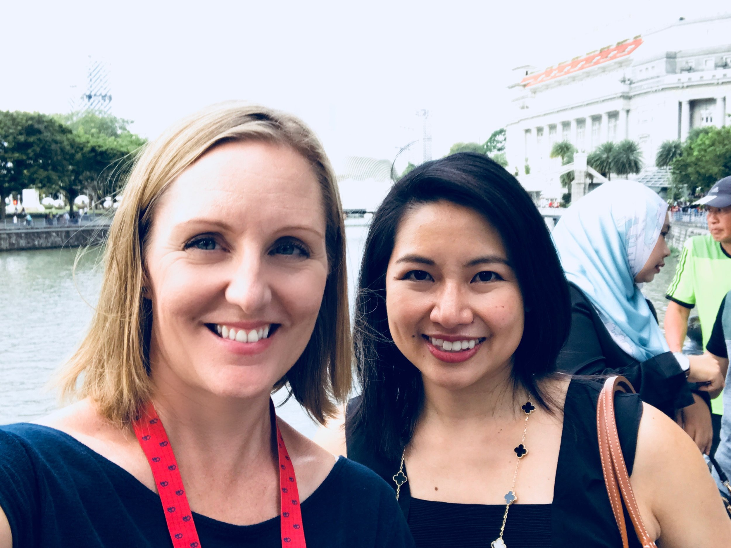 Two Amazon Publishing authors catch up beside the Singapore River