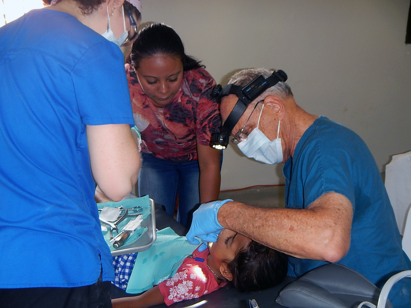 CWE Dentist working on patient