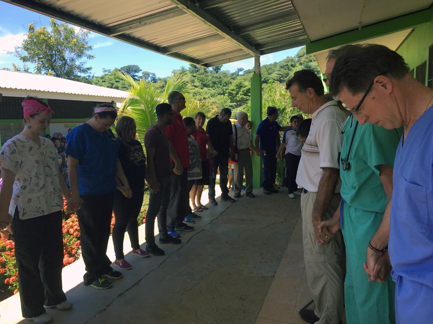 CWE Medical Team Praying