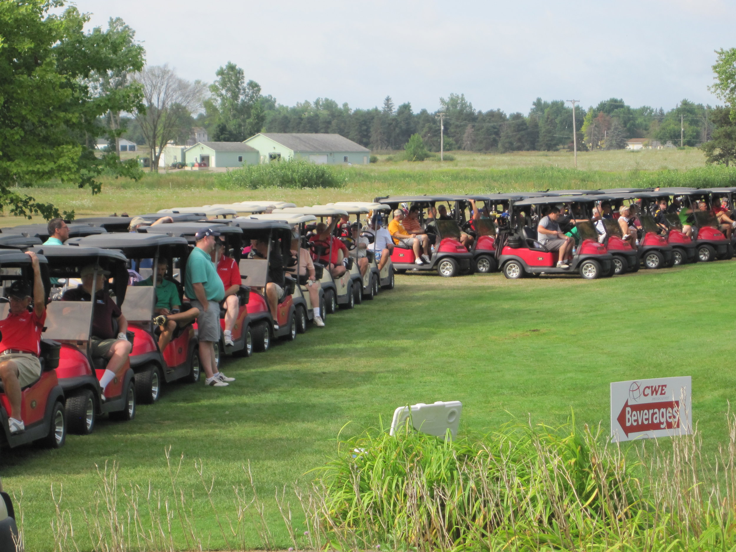 CWE Michigan Fundraiser golfers in carts