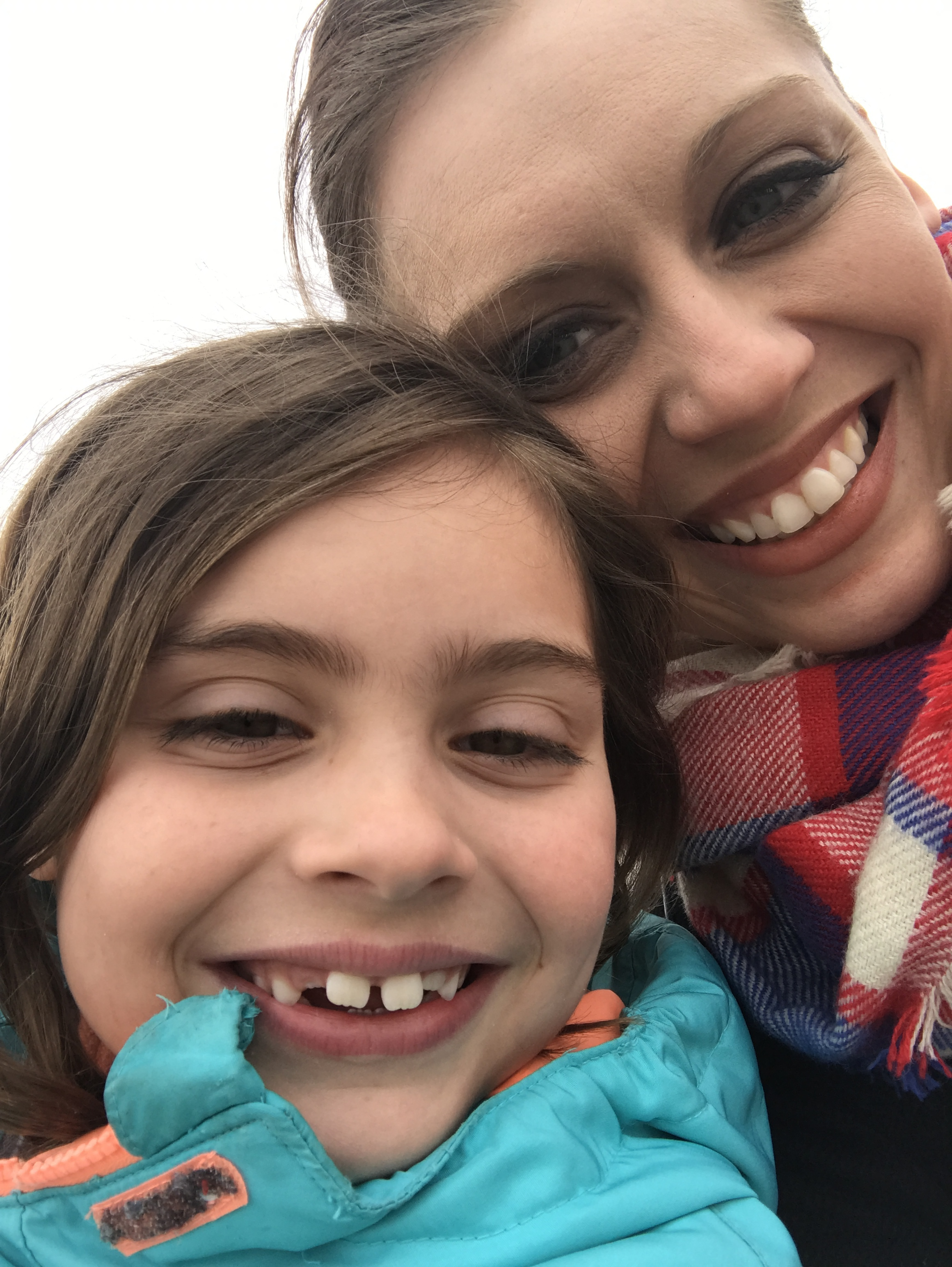 Sorry for the super awkward close up. We were on the swings at her school during recess this week. Sometimes we just have to take what we can get, right?