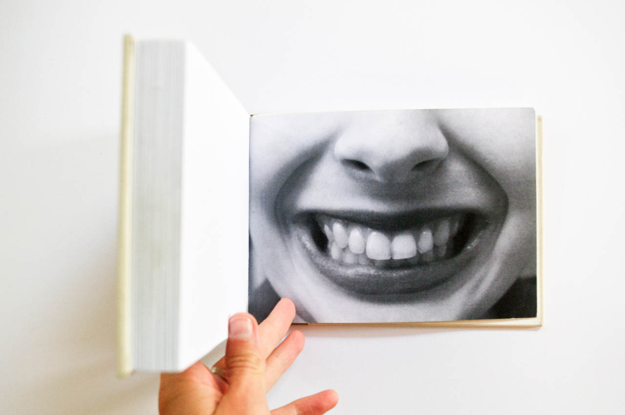 Book Of Smiles,  2011  50 smiles photographed over 30 minutes. Digital prints in hand-bound book.