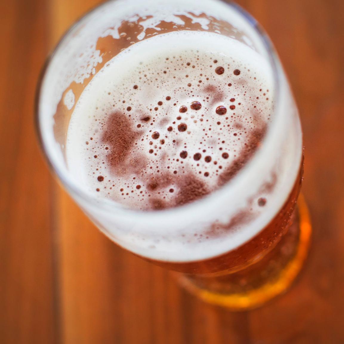 Glass of beer. Links to Hoppy beer descriptions.