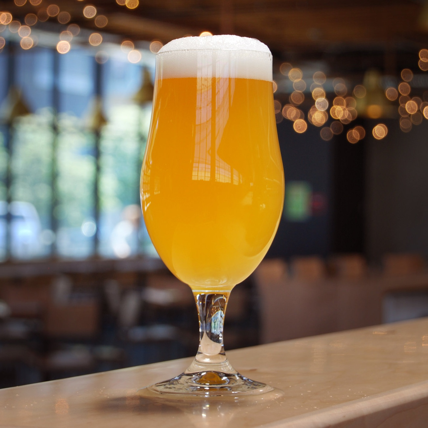 Glass of Late to the Party hazy I.P.A.