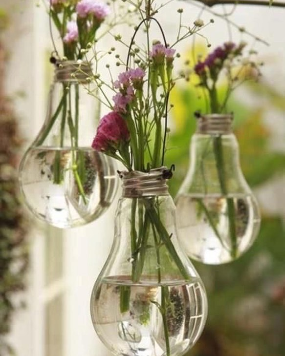 Repurposed light bulbs as vases. Great way to accessorize your summer events. #flowers #summer #summerevents #summerparty #vases #diy #pinterest #nyc #nyevents #partyideas #partystylist #partyplanner #nyceventplanner #doyenneeventsbytiffany #eventer #eventplanner #partyplanner