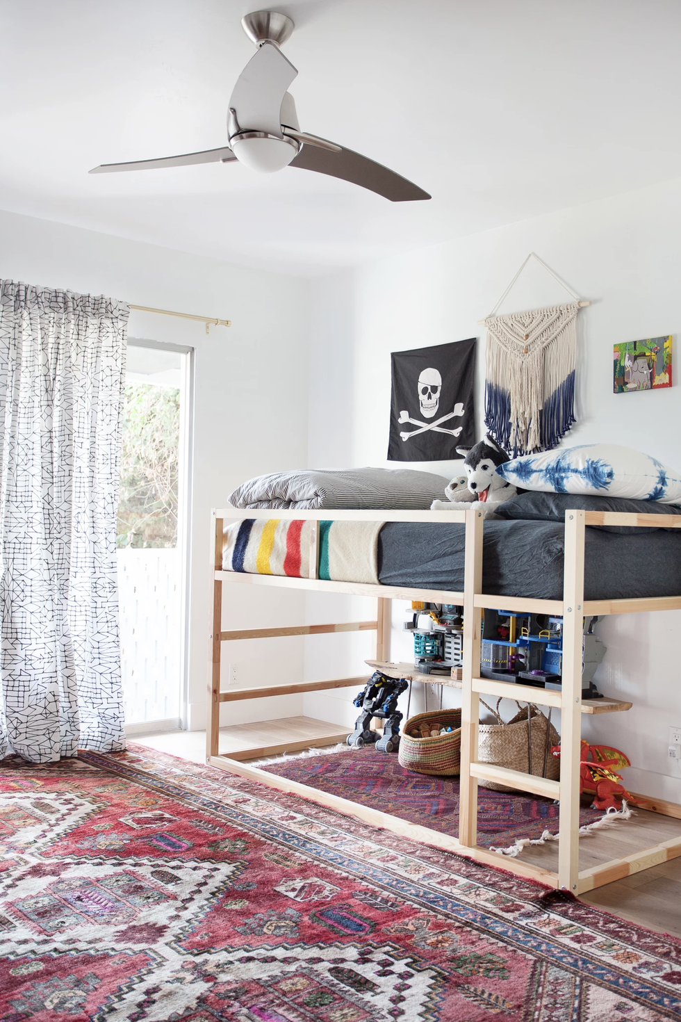 Space under a bunk bed can be utilized for any sort of toy storage! You can either use it as a home for toys, or turn it into a play area where toys are also stored! Via:  House Beautiful