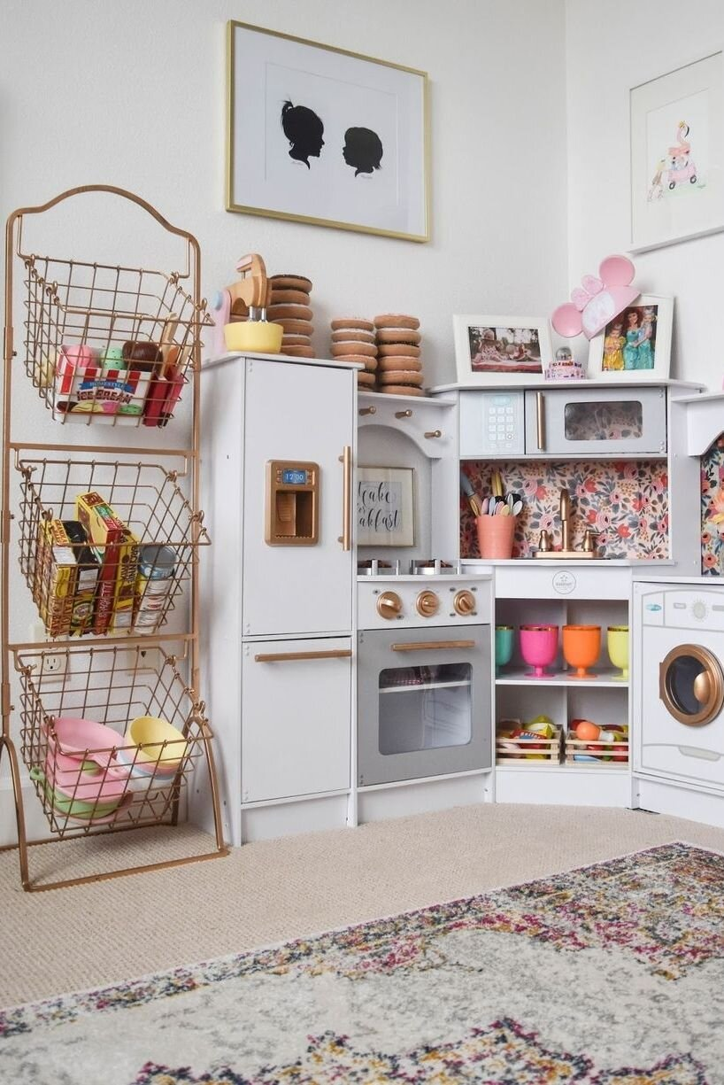Is there anything better than an organized kitchen? We think not! Incorporating designated toy storage area in the play area is also a great way to encourage easy clean -up once playtime is over. Via:  House Beautiful