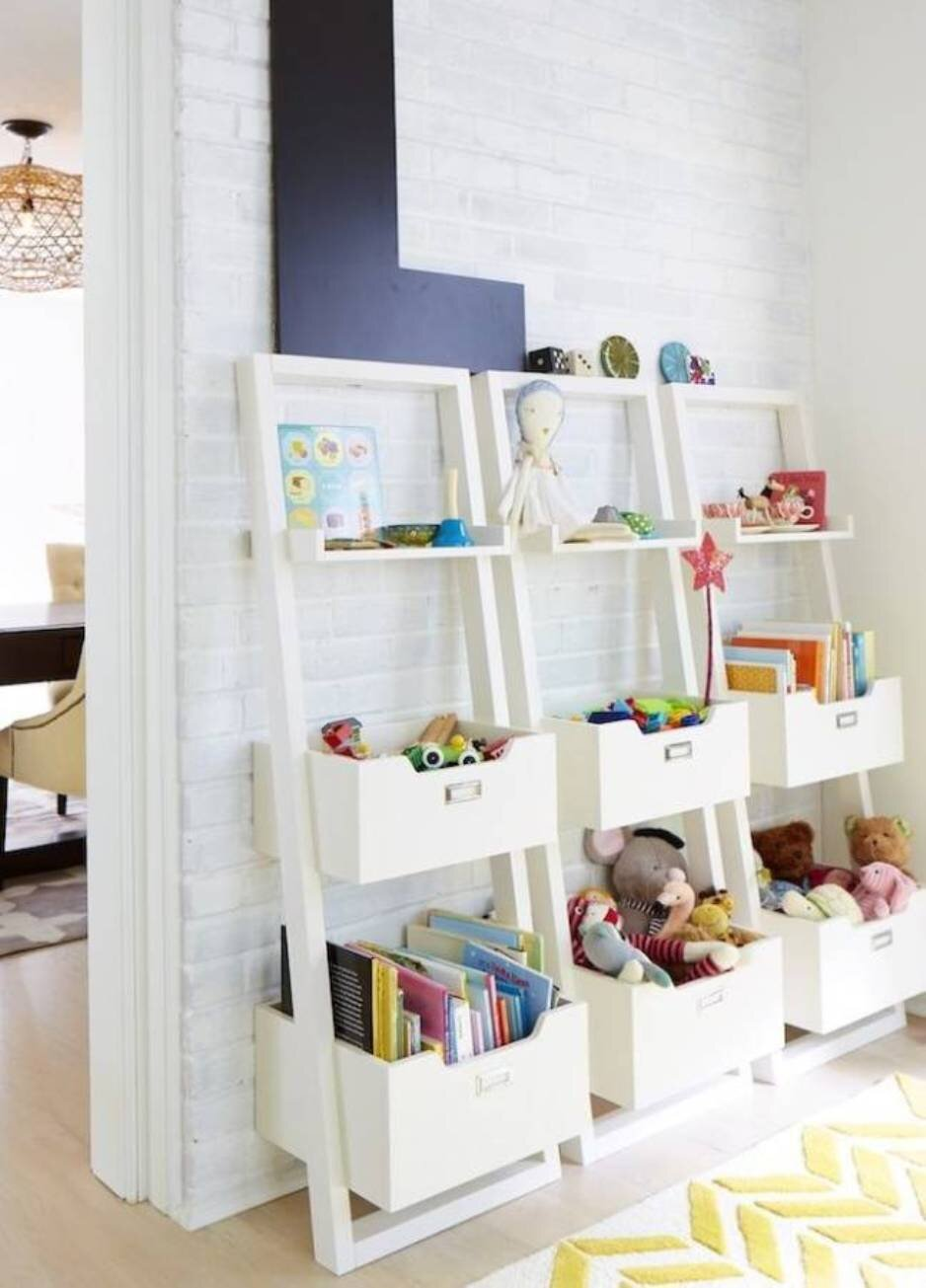 We love this idea! Not only does it give each toy a home but it's also a place to display toys to encourage playtime over screen time! Via:  Home BNC