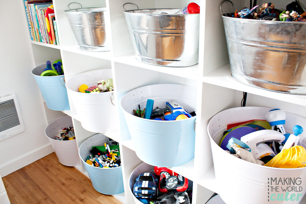 One of the easiest and most efficient ways to organize kids play areas is BINS! Even if you don't have shelving to place them in or on, it's a simply way to have a designated home for each toy. You can even take it a step further by labeling or using each bin for specific toys! Via:  Home BNC