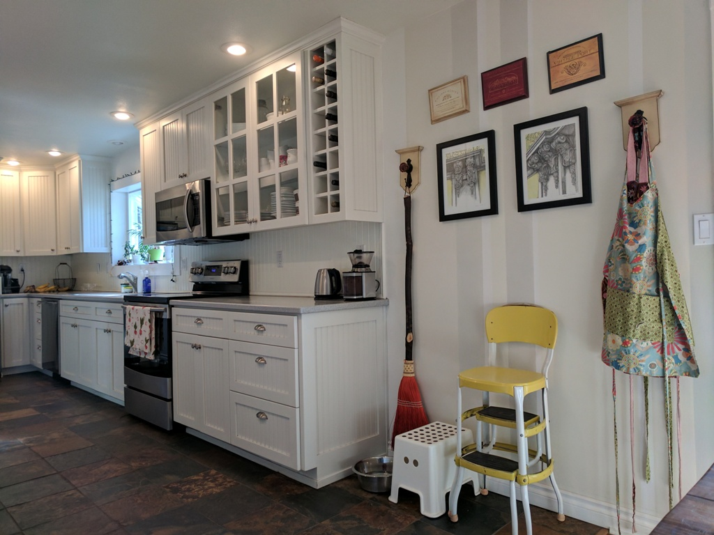 Check out the painted walls, accented with daily aprons and that stool. So special!